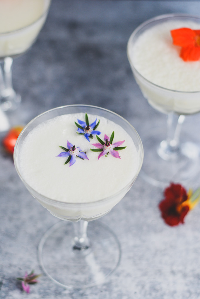 Gin Fizz topped with edible flowers
