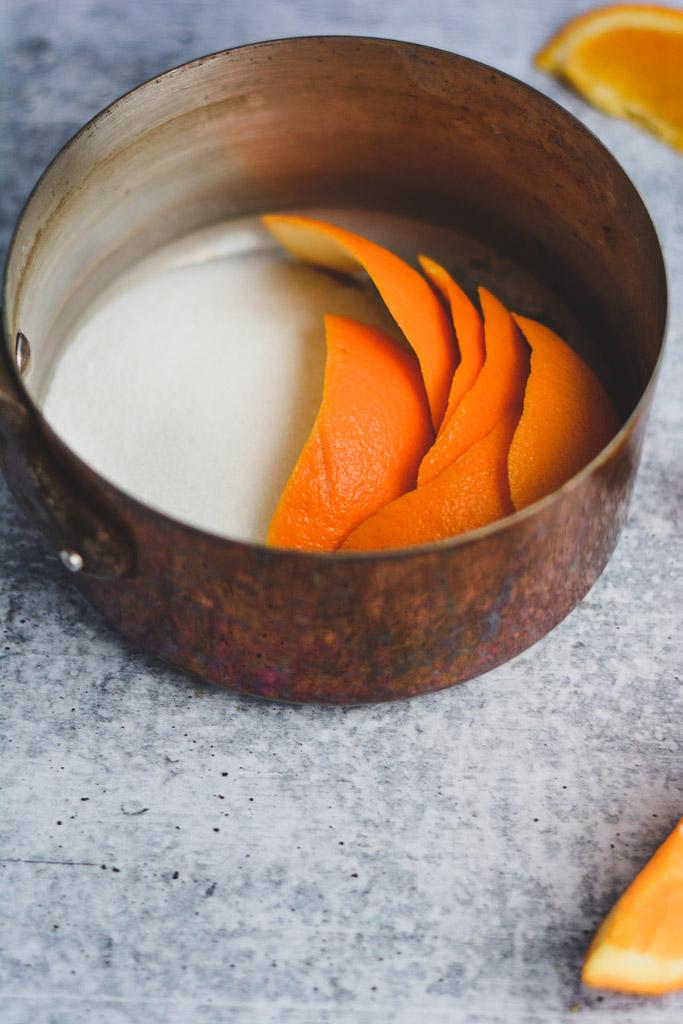 Orange rinds and sugar in a pot