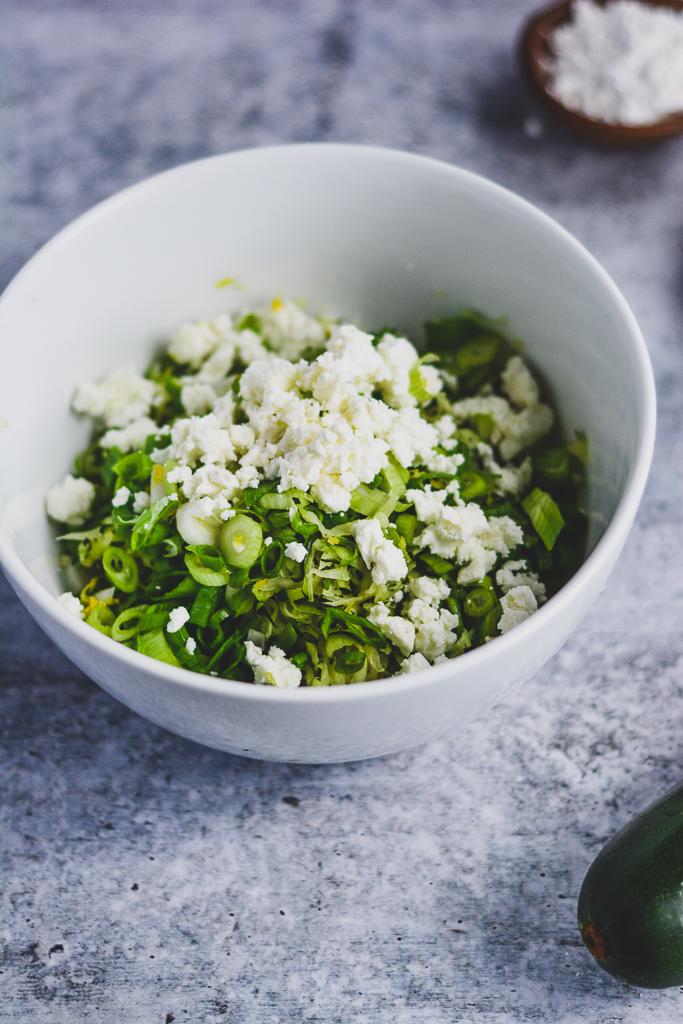 Shredded zucchini, green onion, parsley, and feta