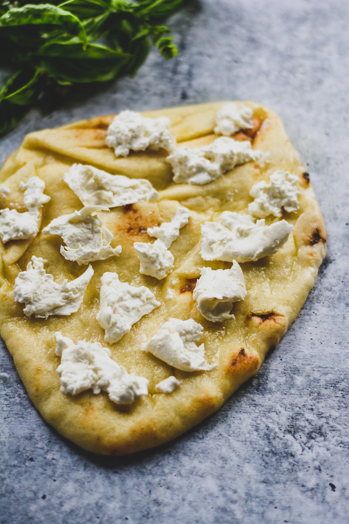 Naan brushed with olive oil and topped with fresh burrata