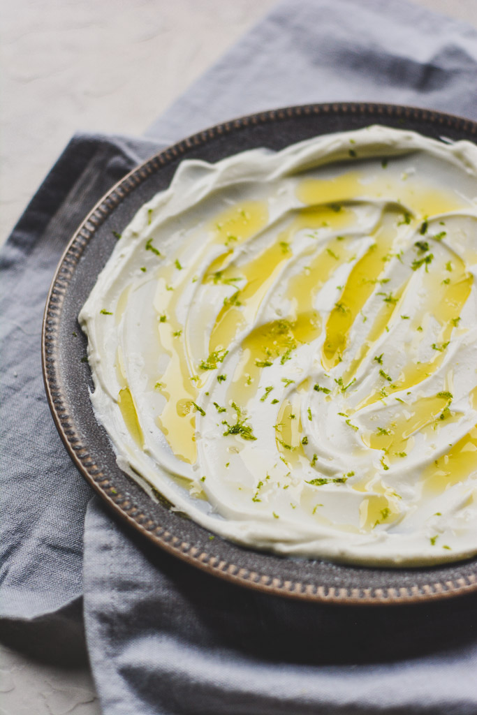 Creamy, swirled Greek yogurt with olive oil and lime zest