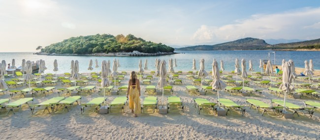 Girl walking on beach (Ksamil, Albania)
