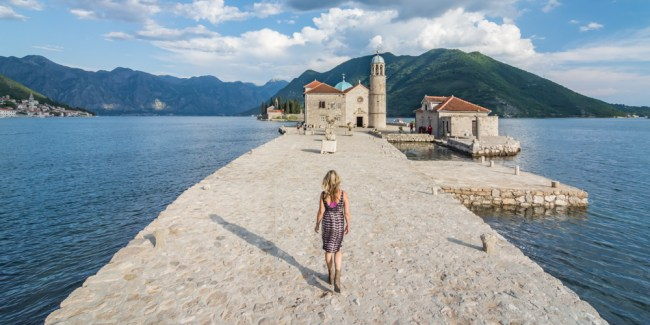 Girl walking towards church on an island
