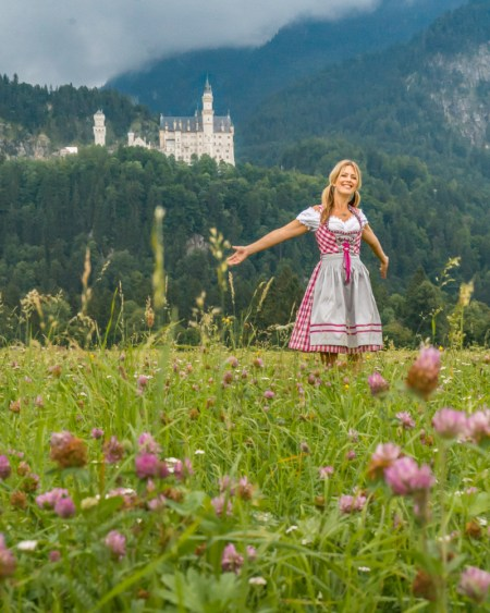 Dirndl Dancing at Neuschwanstein Castle, Germany by Wandering Wheatleys
