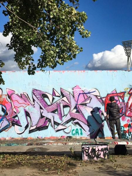 Graffiti Artist in Mauer Park, Berlin, Germany by Wandering Wheatleys