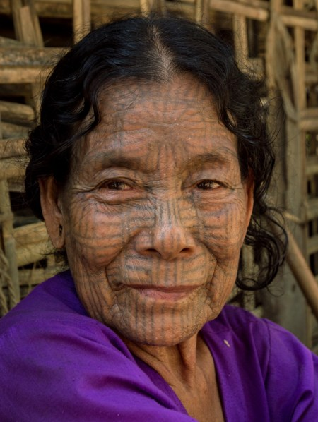 Tattooed Face woman from the Chin Villages, Myanmar by Wandering Wheatleys
