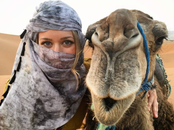 Val and her camel in Morocco by Wandering Wheatleys