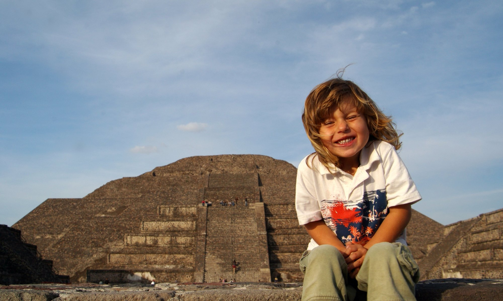 Alex sitting in front of the Pyramid of the Sun