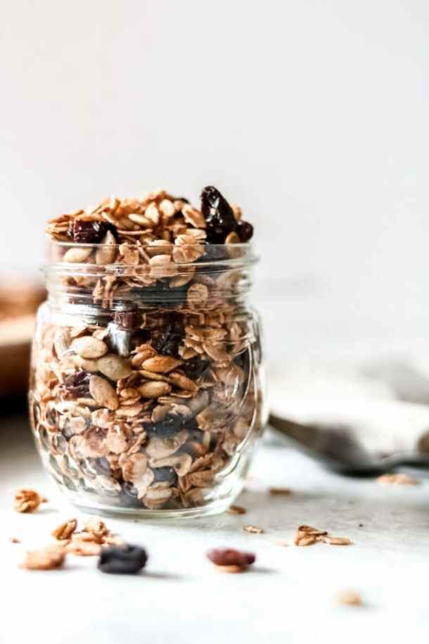 a jar of homemade cinnamon and raisin granola