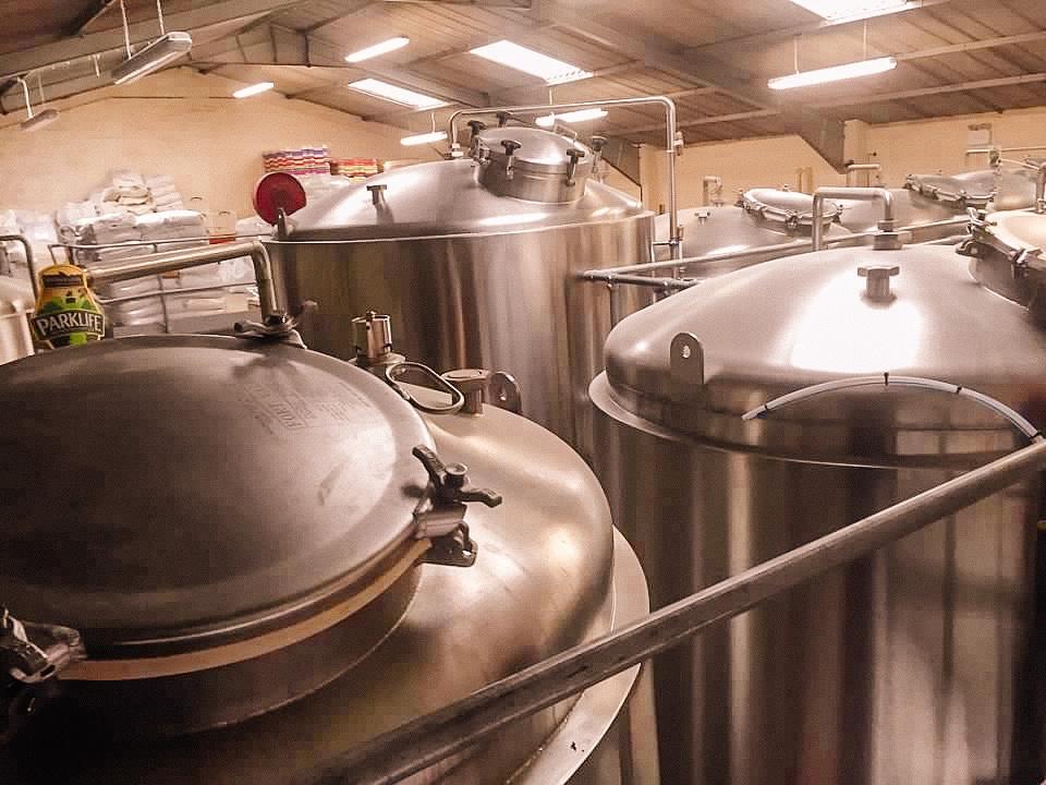 Steel vessels holding beer in a brewery in Windsor United Kingdom Europe. European Beer Travel
