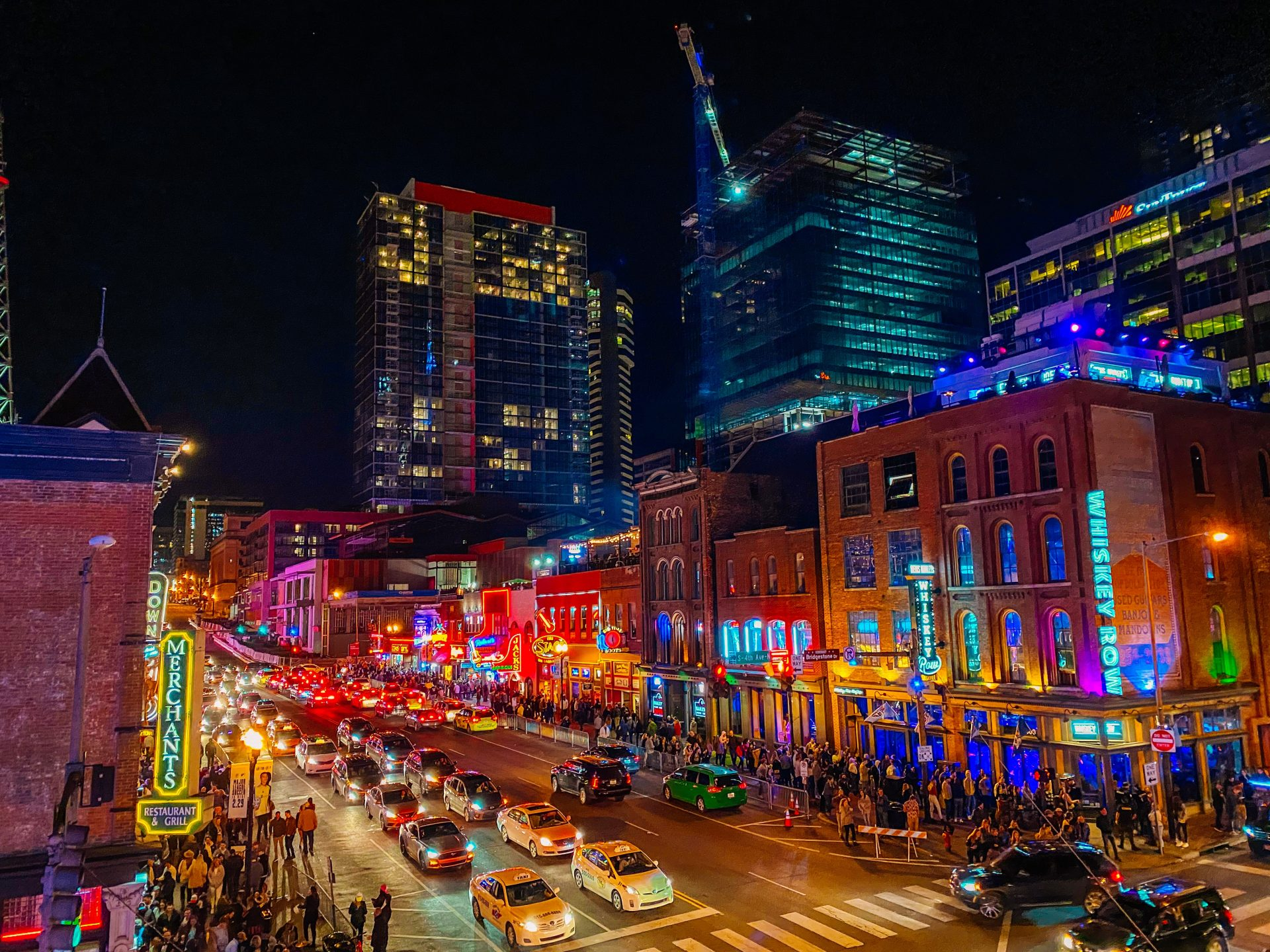 The view from honky tonk central an establishment/bar on Broadway street in downtown Nashville Tennessee. Nighttime bright lights and the music scene.