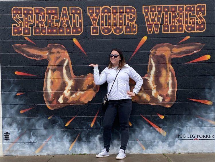 Spread your wings mural outside of peg leg porker restaurant