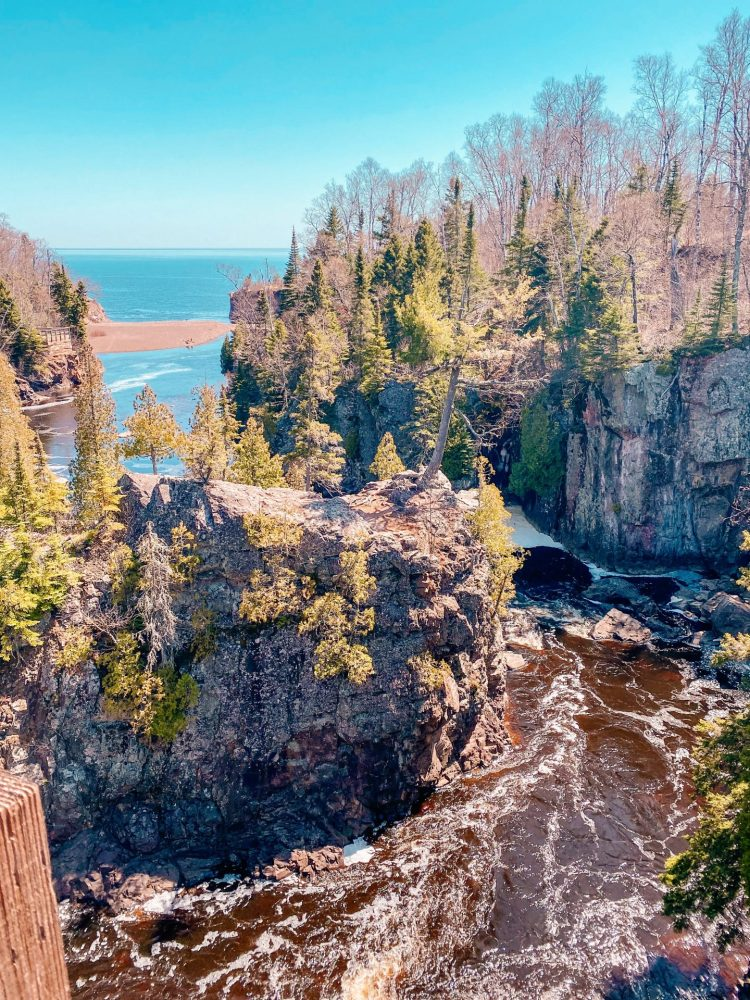 Beautiful tettegouche state park river and part of lake superior and the lush trees and green forest