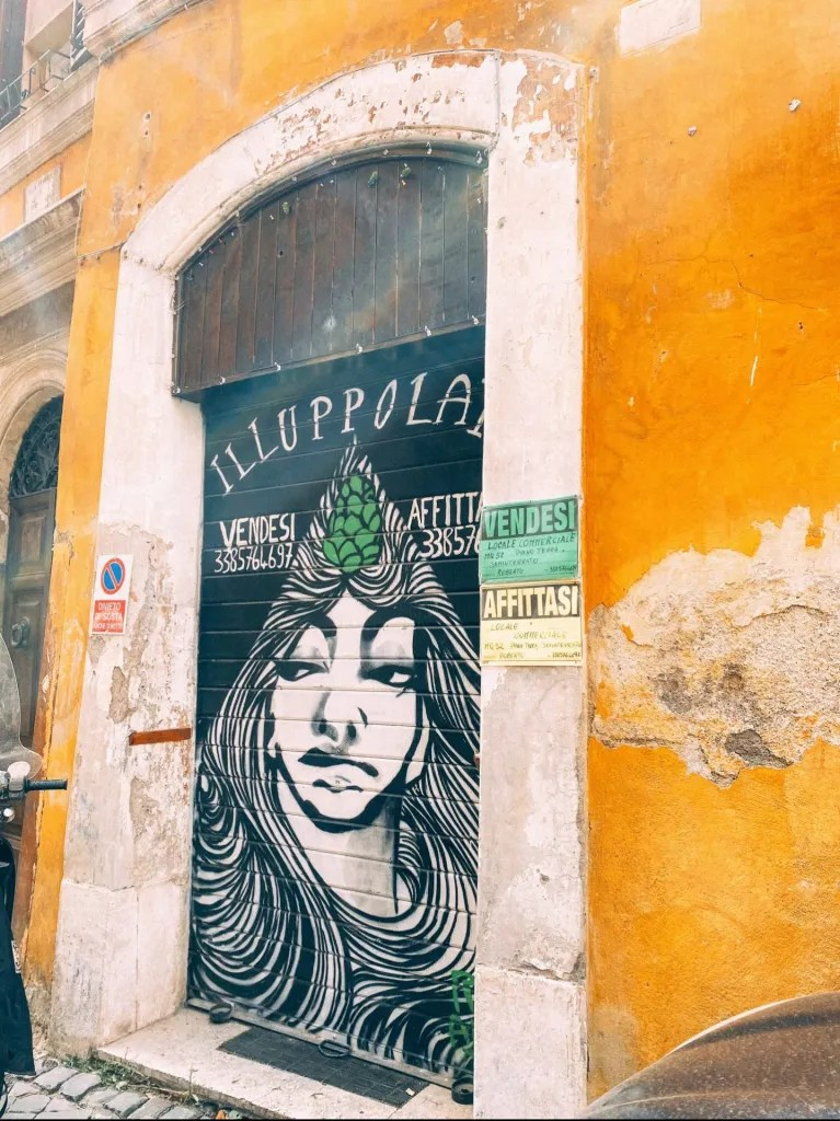 The front of what used to be a craft beer spot in Rome Italy. For sale sighs on the outside.