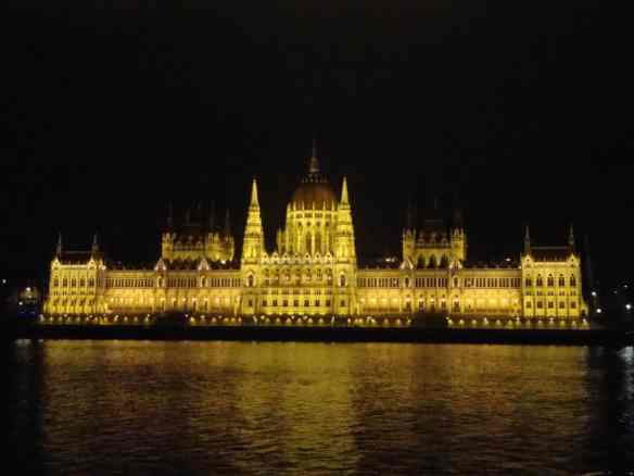 Budapest parliament lights up the night sky across the Danube