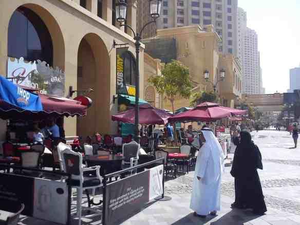 Emiratis walking along ritzy Jumeirah, checking out IHOP.