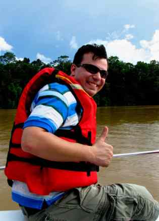 Alex on a boat along the Kinabatangan