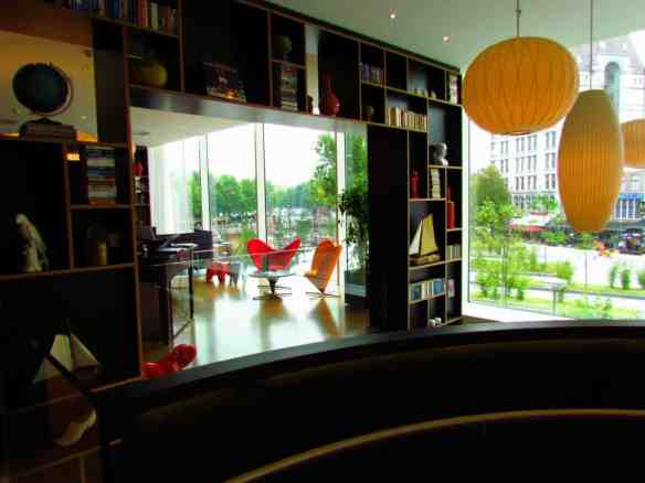 The lobby of the modern CitizenM hotel, with a view of Rotterdam's Oude Haven.