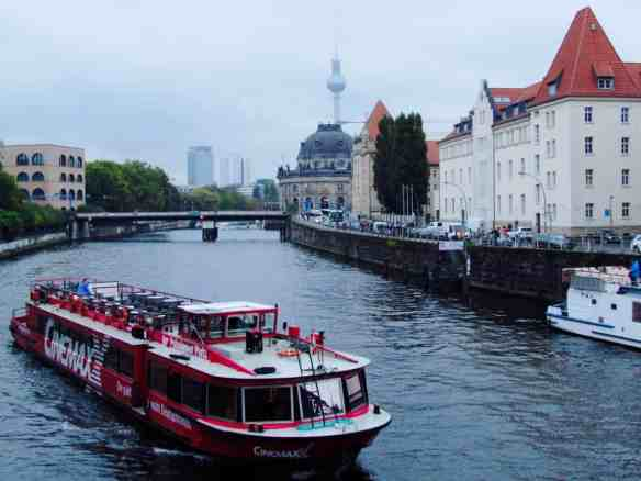 Lots of tourist boats sail down the Spree River around Museum Island.