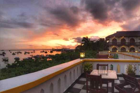 Sunrise over the sea, boats and balcony