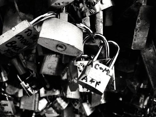 To symbolize that our love is unbreakable, I fastened my lock on the love bridge and threw the keys into the river.