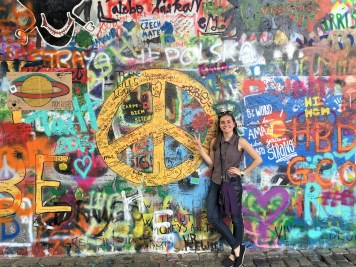 """the Lennon wall: I love the graffiti above the peace sign saying """"Czech mate"""""""