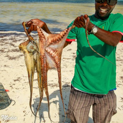 A fisherman with his fresh catch near Paje Beach