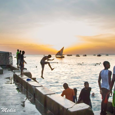 Kids jumping into the ocean near Stone Town