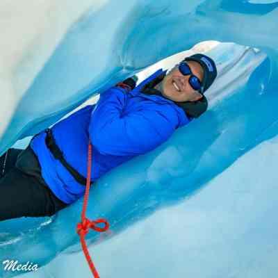 Crawling thru an ice tunnel on Franz Josef Glacier