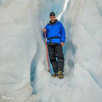 Posing on an ice formation on Franz Josef Glacier