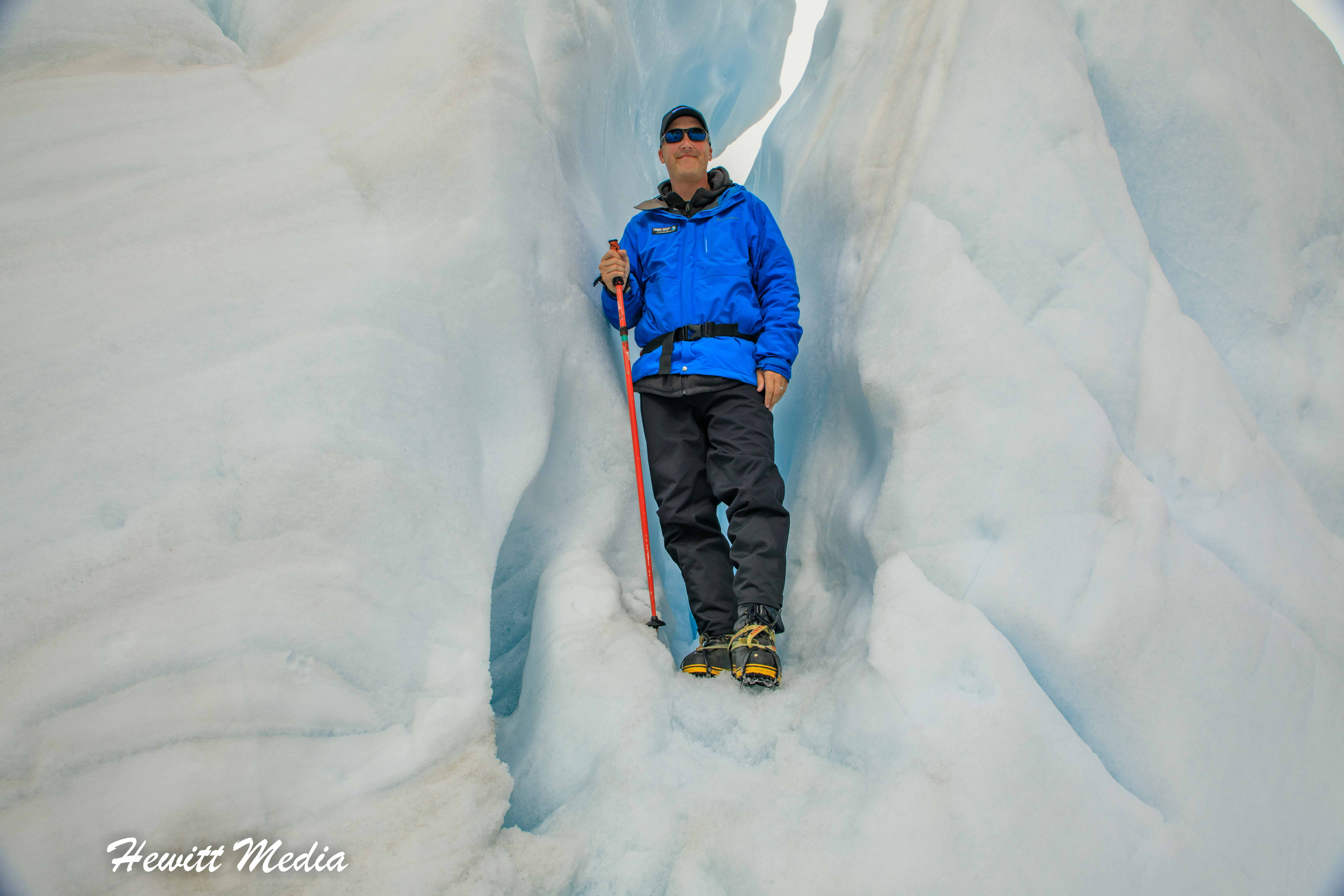 Posing on an ice formation on Franz Josef Glacier