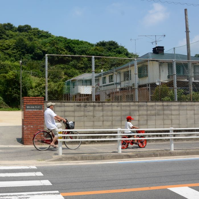 onomichi japan shimanai kaido mukoujima cyclists child