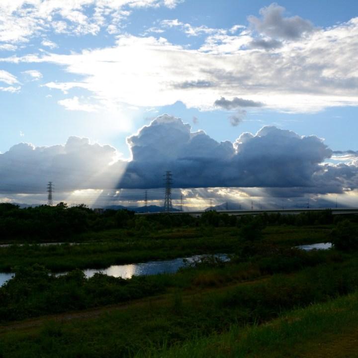 tama river cycling clouds sun
