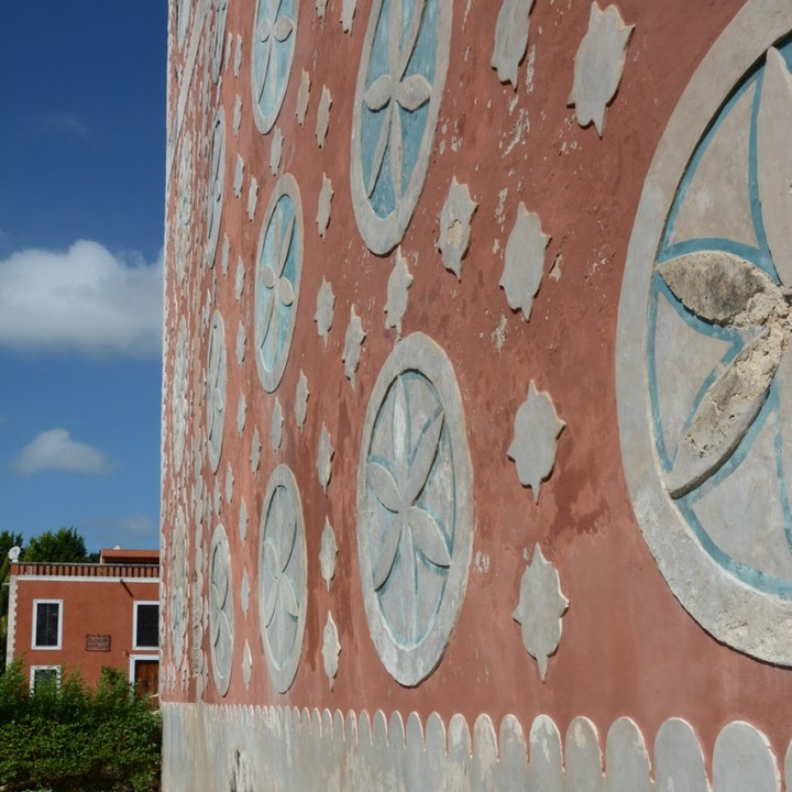 travel with children kids mexico uayma church convent stucco flowers