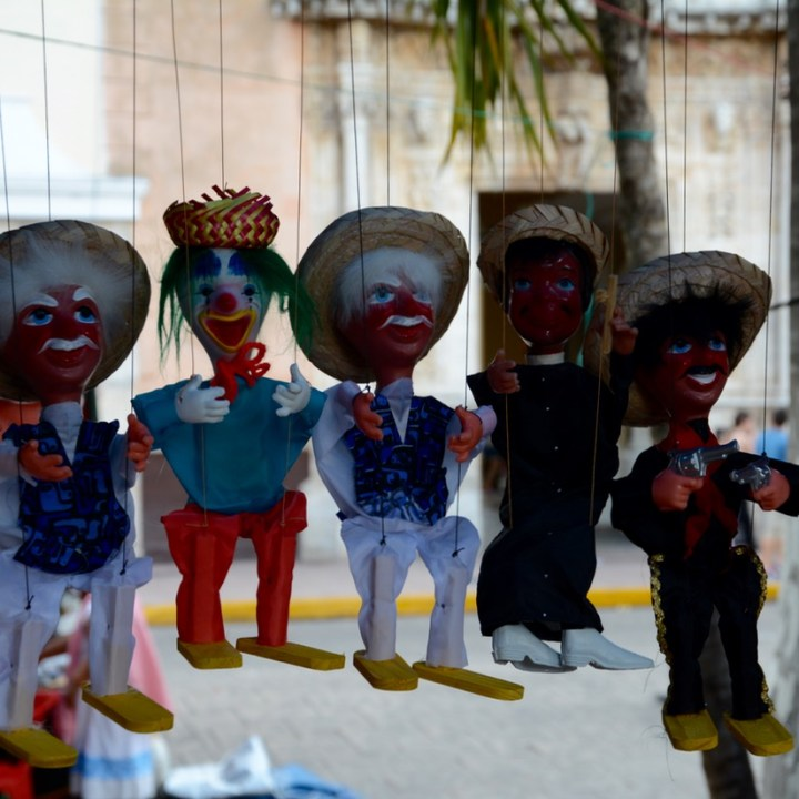 Travel with children kids mexico merida sunday market plaza grande puppets
