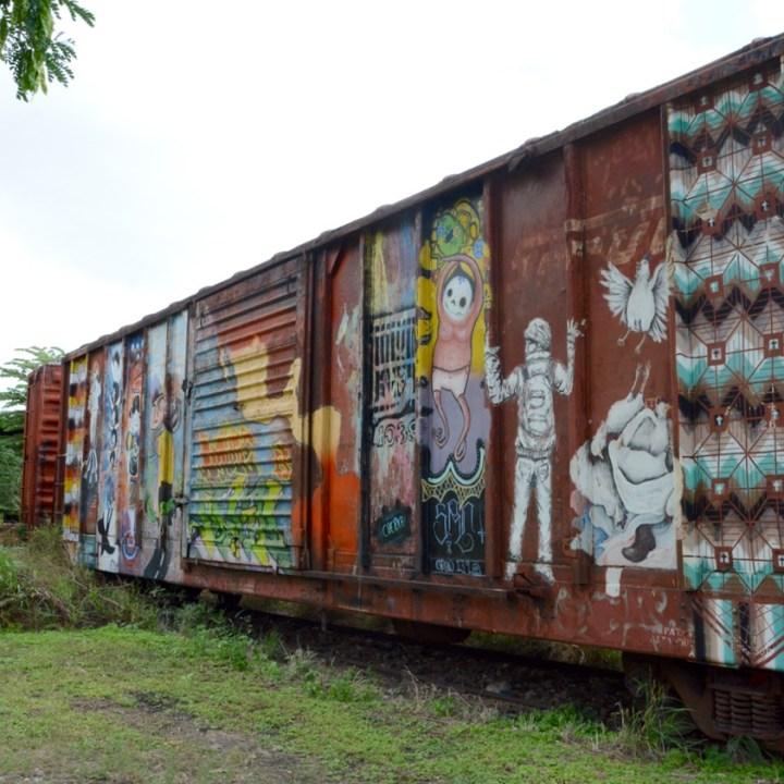 Travel with children kids mexico merida train museum graffiti