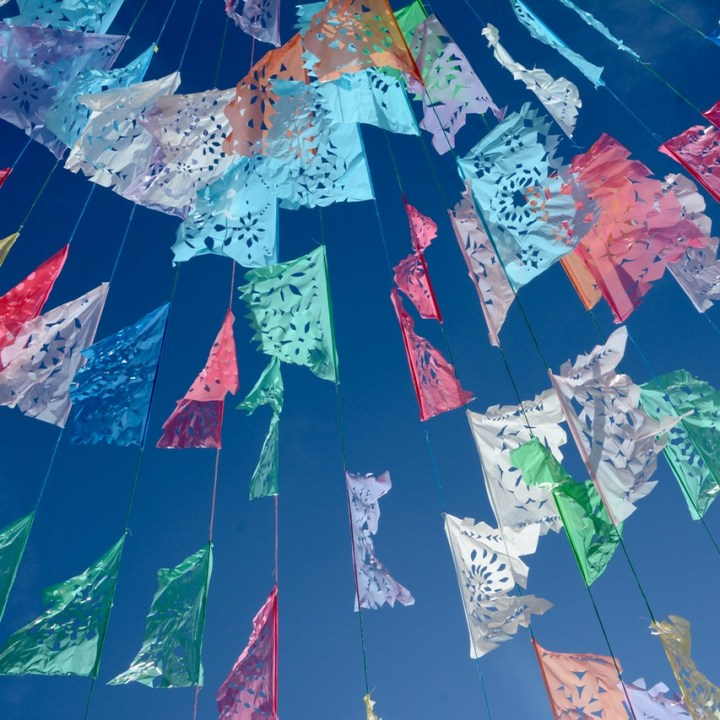 Travel with children kids mexico merida izamal street decoration colourful bunting
