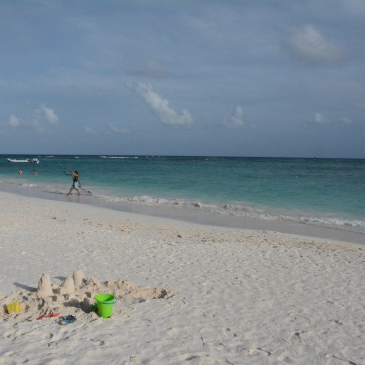 Travel with children kids mexico playa del carmen kite surfing