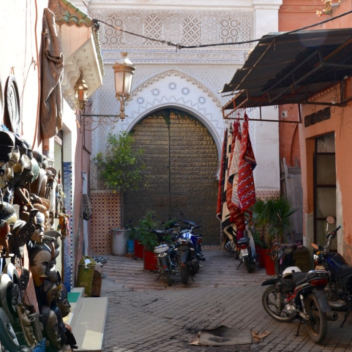Travel with children kids Marrakesh morocco medina secret garden side street