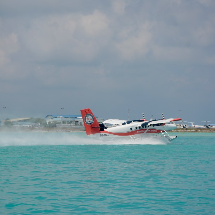 travel with children kids maldives lux south ari atoll seaplane takeoff