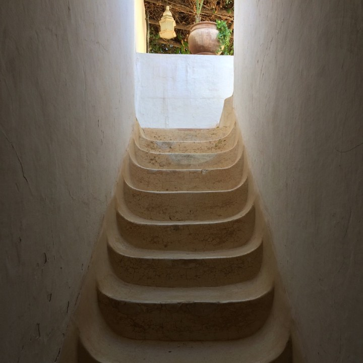 travel with kids children morocco marrakech hotel caravanserai stairs