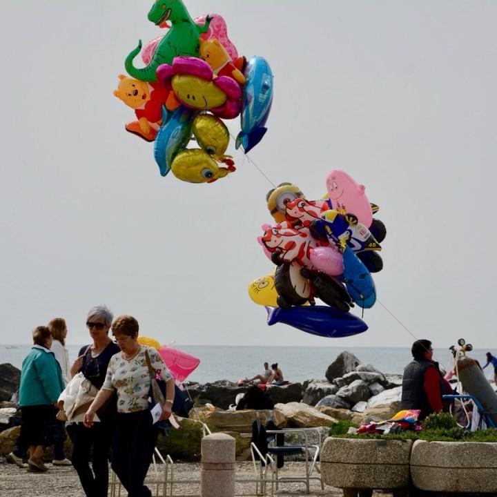 travel with kids children pisa italy marina di pisa sunday market balloons