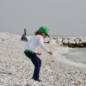 travel with kids children pisa italy marina di pisa beach stone collecting