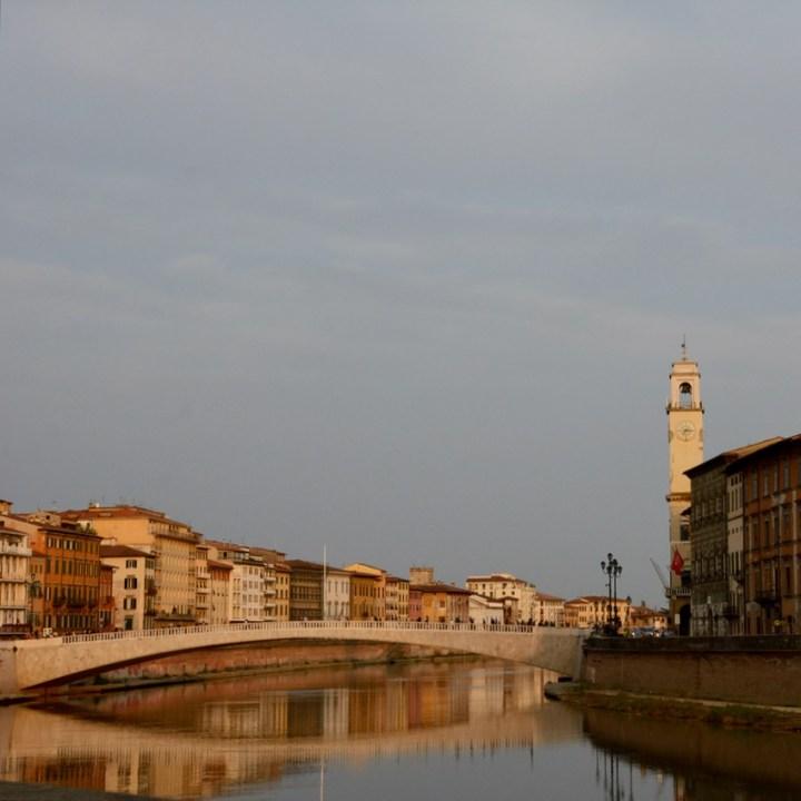travel with kids children pisa italy river arno bridge sunset