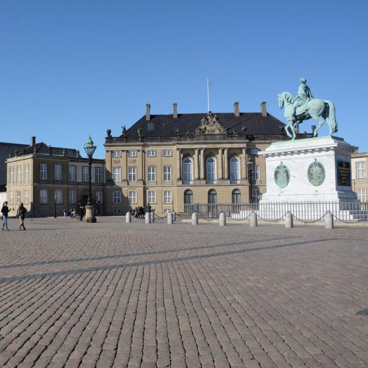 travel with kids children copenhagen denmark amalienborg palace square statue