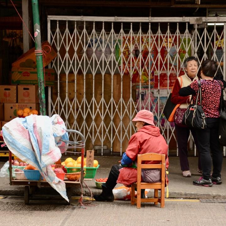 hong kong with kids children kowloon old fruit market oranges