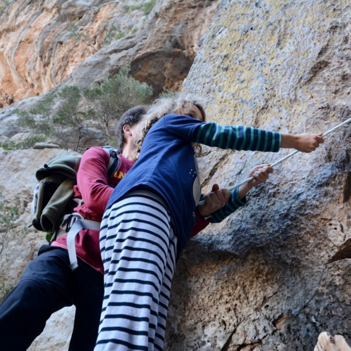 travel with kids children soller mallorca spain hiking torrent de pareis hold on