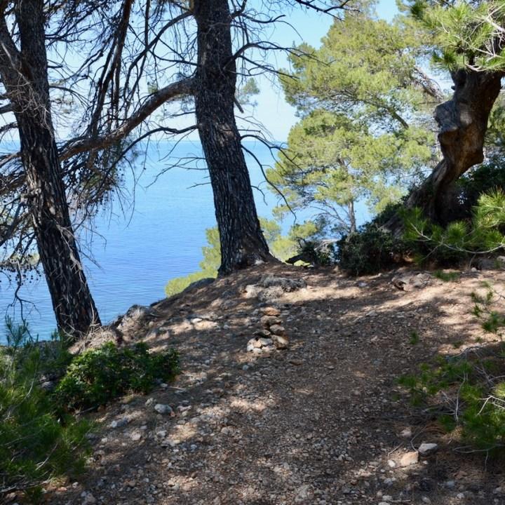 travel with kids children soller mallorca spain coastal hike ben's d'avall to cala deia stone marker