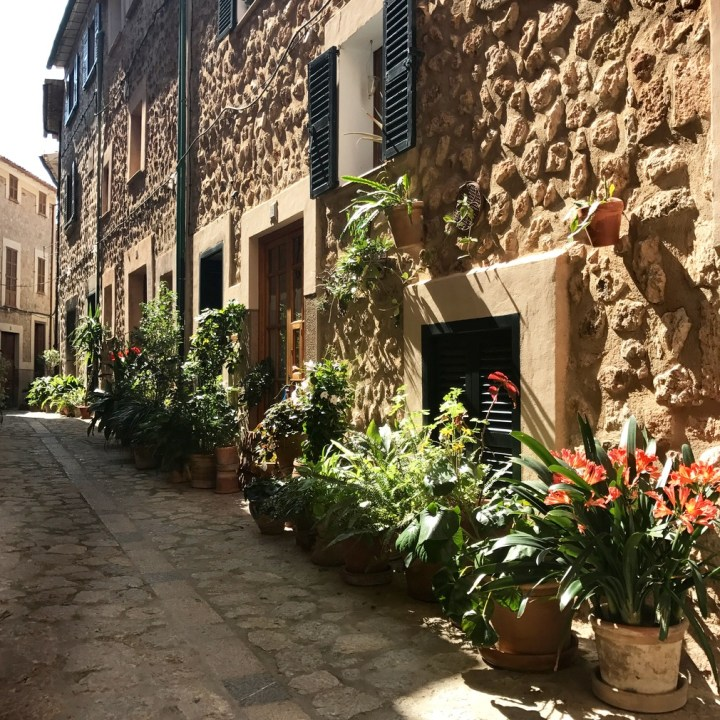 travel with kids children soller mallorca spain town alleys