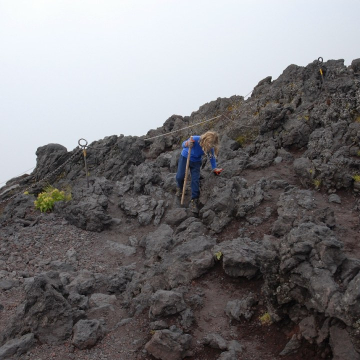 travel with kids hiking mount fuji japan crossing rocks